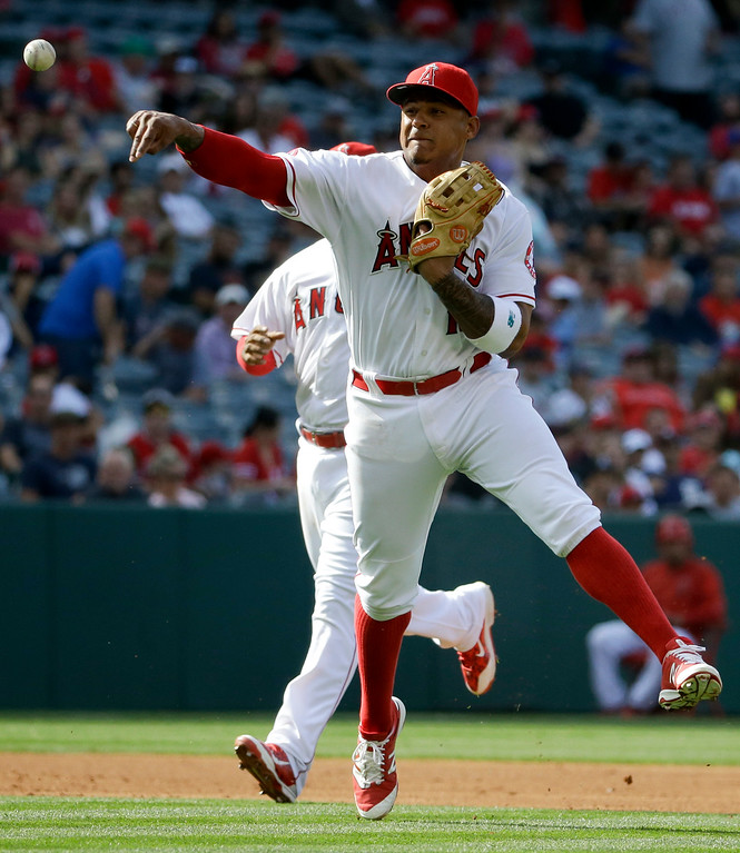 . Los Angeles Angels third baseman Jefry Marte throws to first after fielding a ball hit by Detroit Tigers\' Jose Iglesias during the third inning of a baseball game in Anaheim, Calif., Wednesday, June 1, 2016. Iglesias was safe at first. (AP Photo/Chris Carlson)
