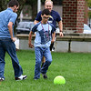 Lowell High School Life Skills students played some soccer on Friday afternoon during the new Fun Friday program this year. Fighting for control of the ball is students, from left, Brenden Dupont and Sam Field. Just behind them is Life Skills teacher Lenny Rapone. SUN/JOHN LOVE