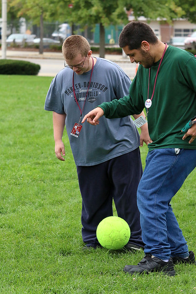 Lowell High School Life Skills students played some soccer on Friday afternoon during the new Fun Friday program this year. Students Alex Moore and Chris Soiles fight for control of the ball. SUN/JOHN LOVE