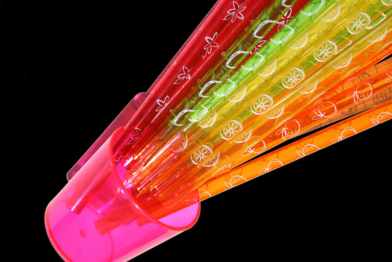 rainbow straws on black