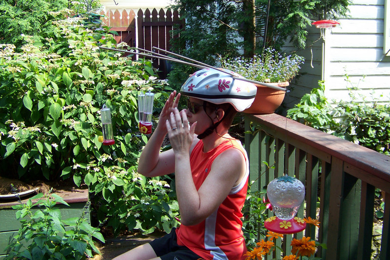 OK...the Hummingbird Helmet is fully assembled and precariously balanced on Patti's head as she takes her seat among the garden flowers.
