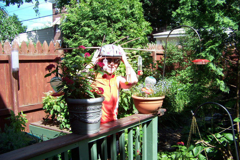 Camouflage!  Patti disguises herself between the flowerpots.