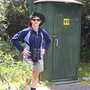 The rakish angle of Patti's hat can be attributed to the influence of New Zealand culture.  We saw this lovely latrine on a hike to Fox Glacier; there weren't many trees available on the glacial plain, so the wise New Zealand parks department installed latrines in strategic places.  January, 2006