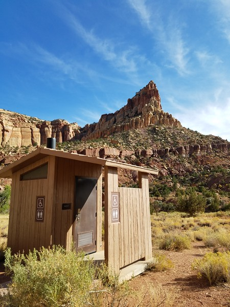 The latrines here blend in nicely with their surroundings.  Red rock and blue sky!  Capitol Reef National Park, Utah, September 22, 2019
