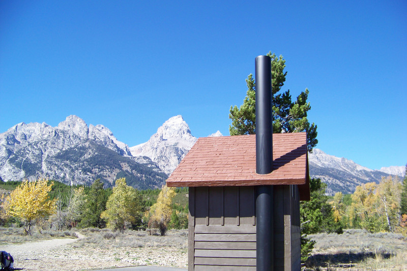 """Our friend Dale said """"If I had some air freshener and a camp stove, I'd live there"""". We might not go that far, but this outhouse has a very nice view. Grand Teton National Park, Wyoming, October 2007"""