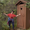 Patti presents the latrine outside our cabin at Camp Denali, Denali National Park, Alaska. August 2000