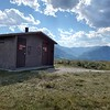 This is another view of the wonderful latrine at the Clark's Fork overlook on the Chief Joseph Scenic Byway.  The Absaroka mountains are in the background.  August 12, 2021.