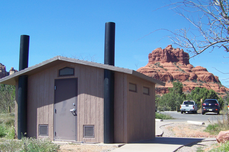 On vacation in Arizona, we stop to gawk at Bell Rock, one of Sedona's famous red-rock formations, and this nicely situated latrine is a bonus.  Arizona, April 2011