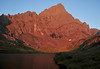 "Sangre de Cristo means ""blood of Christ.""<br /> Sunrise paints the bloodlike alpenglow upon<br /> Lower South Colony Lake and Crestone Needle."