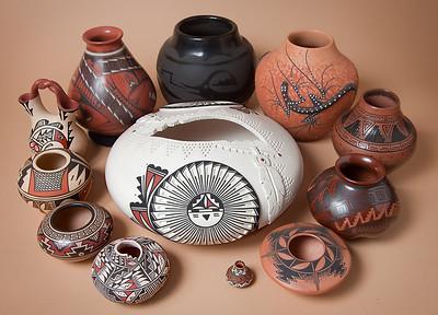 "Southwestern pottery, CW from top: San Ildefonso, Zuni, Navajo, Mata Ortiz, Santo Domingo, Acoma, Acoma, Mata Ortiz, Hopi, Jemez, Mata Ortiz; center: Laguna, 10"" dia."