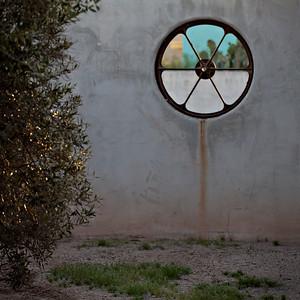 Wheel window, barrio, Tucson, AZ