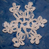 "<a href=""http://www.snowcatcher.net/2009/11/snowflake-monday.html"" target=""_blank"">Super Simple Plarn Snowflake</a>"