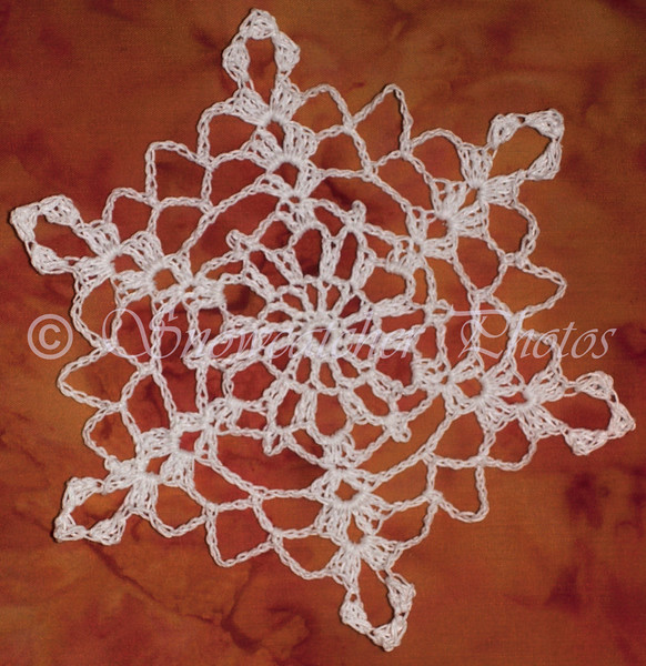 """The <a href=""""http://www.snowcatcher.net/2009/09/snowflake-monday.html"""" target=""""_blank""""> first original snowflake pattern</a> I published and shared!"""