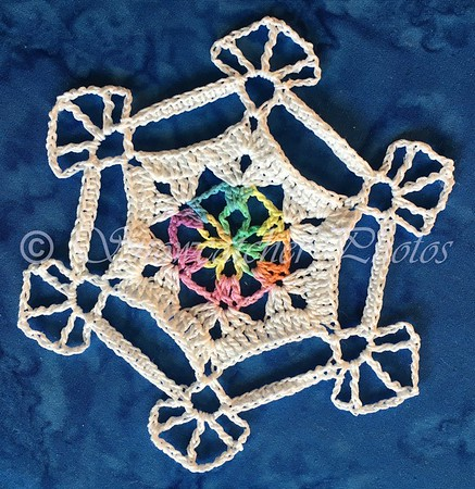 Crocheted snowflake Ice rainbow 2 - made by Snowcatcher