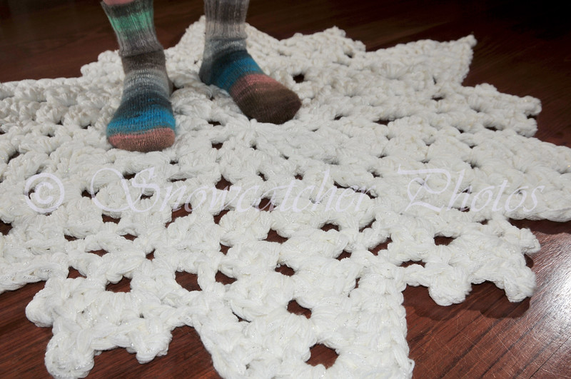"""<a href=""""http://www.snowcatcher.net/2011/02/snowflake-monday_28.html"""" target=""""_blank"""">Ice Mountain Snowflake Rug</a> and homemade Noro socks!!!"""