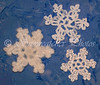 "<a href=""http://www.snowcatcher.net/2009/11/snowflake-monday.html"" target=""_blank"">Super Simple Plarn Snowflakes</a>"