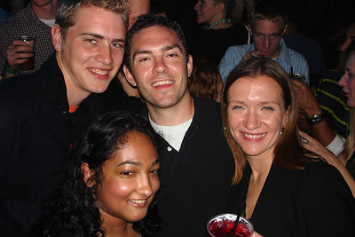 Rob, Luke, Jyothi, and Erin enjoying the end of the season party for DC Kickball.  Mark lurks in the background - Washington, DC ... October 14, 2006
