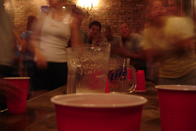 Playing flip cup at Tom Tom's - Washington, DC ... August 23, 2006 ... Photo by Rob Page III