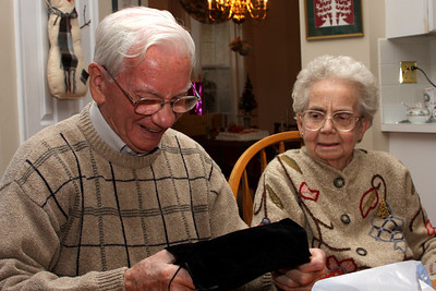 Grandpa pulling out Rob and Emily's wedding album - Phoenixville, PA ... December 27, 2008 ... Photo by Bob Page Jr.