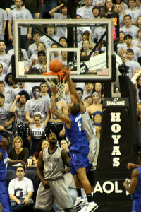 Monroe swats the shot away - December 13, 2008 ... Photo by Rob Page III