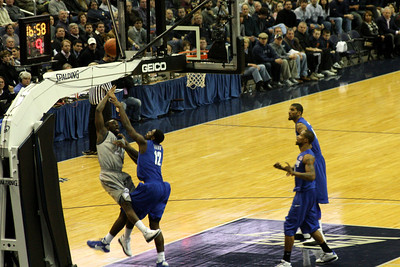 Sapp is fouled as he attacks the basket - December 13, 2008 ... Photo by Rob Page III