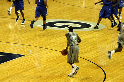 Jason Clark brings the ball up the court - December 13, 2008 ... Photo by Rob Page III
