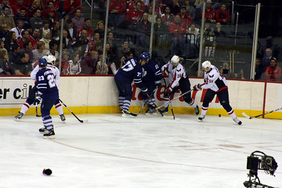 Fighting for the puck along the boards - Washington, DC ... December 28, 2008 ... Photo by Rob Page III