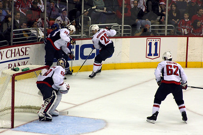 Fighting for the puck in the corner - Washington, DC ... December 28, 2008 ... Photo by Rob Page III