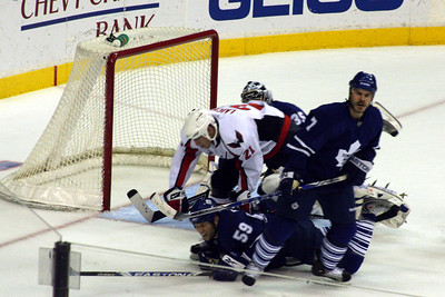 A scrum in front of the net - Washington, DC ... December 28, 2008 ... Photo by Rob Page III