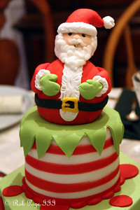 Santa sits atop the cake - Roswell, GA ... December 25, 2009 ... Photo by Rob Page III