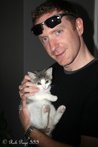 John with his kitten Sophie - Ottawa, ON ... September 27, 2009 .. Photo by Rob Page III