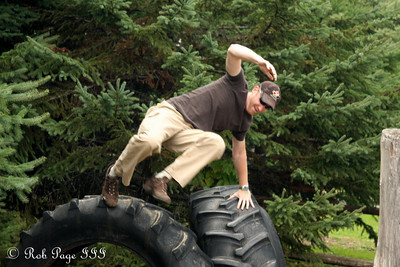 John hurdling the tires - Ottawa, ON ... September 26, 2009 ... Photo by Rob Page III