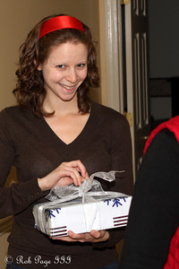Emily sneakily opens her gift - Reading, PA ... November 26, 2009
