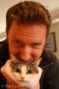 John with his favorite kitten - Washington, DC ... December 25, 2010 ... Photo by Rob Page Jr.