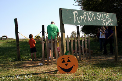 A father and son launch pumpkins with a slingshot at the Corn Maze in the Plains - The Plains, VA ... October 10, 2010 ... Photo by Rob Page III