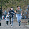 Participating in a fun race at Doyle Field on Thursday November 5, 2020 is from left Maxwell Ramirez, 10, Thorin Litalien, 4, Enrique Kearchner, 9 in the lead, Lisa Kearchner, and Lucas Ramirez, 7, all of Leominster. SENTINEL & ENTERPRISE/JOHN LOVE