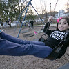 Victoria Sandrelli, 9, of Fitchburg enjoys the swings on the playground at Doyle field on Thursday November 5, 2020 with her twin sister, on right, Stephania. SENTINEL & ENTERPRISE/JOHN LOVE