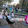 Stephania Sandrelli, 9, of Fitchburg enjoys the swings on the playground at Doyle field Thursday November 5, 2020 with her twin sister, on right, Victoria. SENTINEL & ENTERPRISE/JOHN LOVE