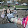 Stephania Sandrelli, 9, of Fitchburg enjoys the swings on the playground at Doyle field on Thursday November 5, 2020 with her twin sister, on right, Victoria. SENTINEL & ENTERPRISE/JOHN LOVE