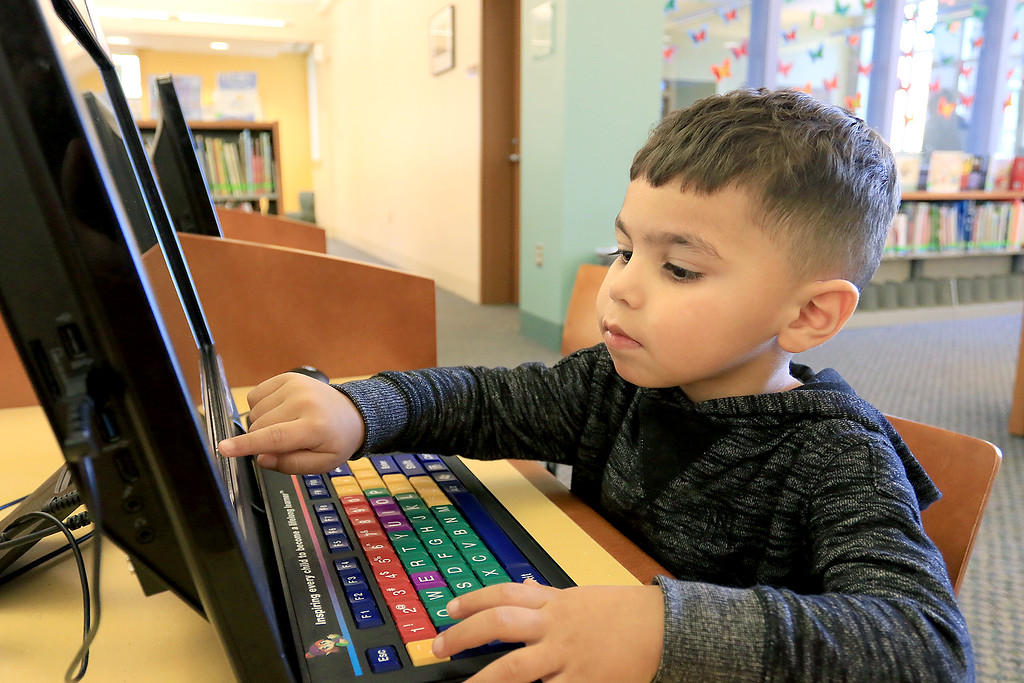 . The Leominster Public Library childrens room is always a great place for kids to come and Learn, play and have fun. Lucas Colon, 3, plays a fun learning game on one of the computers they have in the Children\'s room on Thursday, January 3, 2019. SENTINEL & ENTERPRISE/JOHN LOVE