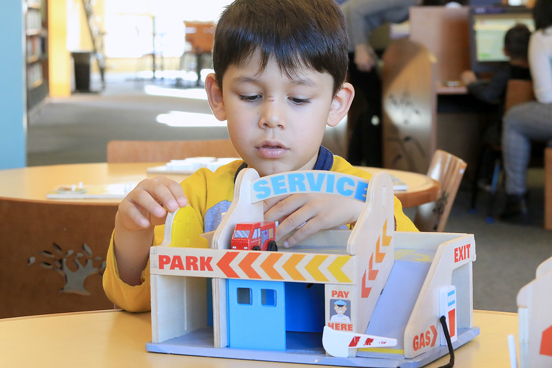 The Leominster Public Library childrens room is always a great place for kids to come and Learn, play and have fun. David Pantigoso, 6, enjoys playing with the wooden toy service station set they have in the Children's room on Thursday, January 3, 2019. He and his family are home visiting family in the area. He lives with his family in Cusco, Peru. SENTINEL & ENTERPRISE/JOHN LOVE