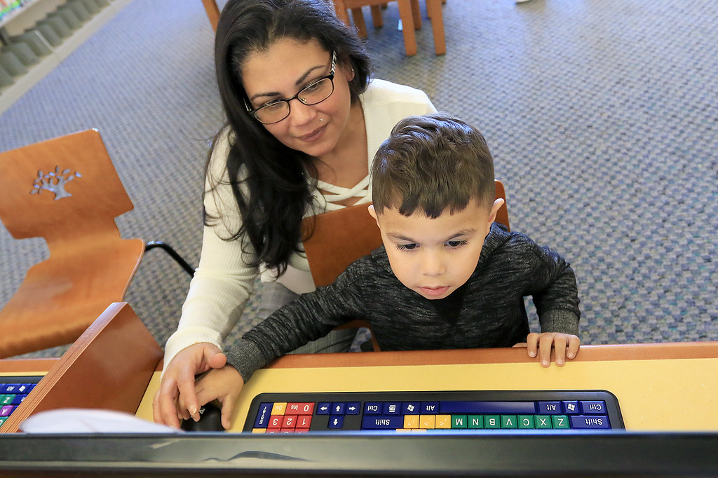 . The Leominster Public Library childrens room is always a great place for kids to come and Learn, play and have fun. Lucas Colon, 3, gets help from his grandmother Vilmary Colon as he plays a fun learning game on one of the computers they have in the Children\'s room on Thursday, January 3, 2019. SENTINEL & ENTERPRISE/JOHN LOVE