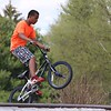 Elie Saa, 13, from Fitchburg does some tricks with his bike at the Ryan C. Joubert Skatepark at Parkhill Park in Fitchburg on Tuesday afternoon. SENTINEL & ENTERPRISE/JOHN LOVE