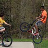 Elie Saa, 13, from Fitchburg does some tricks with his bike at the Ryan C. Joubert Skatepark at Parkhill Park in Fitchburg on Tuesday afternoon. Watching him is Matthew DeVoe, 10, from Fitchburg. SENTINEL & ENTERPRISE/JOHN LOVE