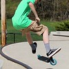 Richard Butler, 12, from Gardner does some tricks with his scooter at the Ryan C. Joubert Skatepark at Parkhill Park in Fitchburg on Tuesday afternoon. SENTINEL & ENTERPRISE/JOHN LOVE