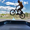 Matthew DeVoe, 10, from fitchburg does a jump with his bike on the bike ramps at Parkhill Park in Fitchburg on Tuesday afternoon. SENTINEL & ENTERPRISE/JOHN LOVE