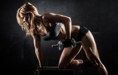 women-workout-dumbbell-pose