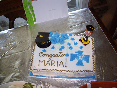 Ria's cheesy graduation cake with the Ria Bobblehead. :)