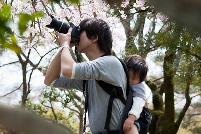 Photographer with Sleeping Child