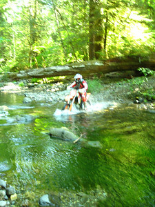 mike crossing the creek on the re-route